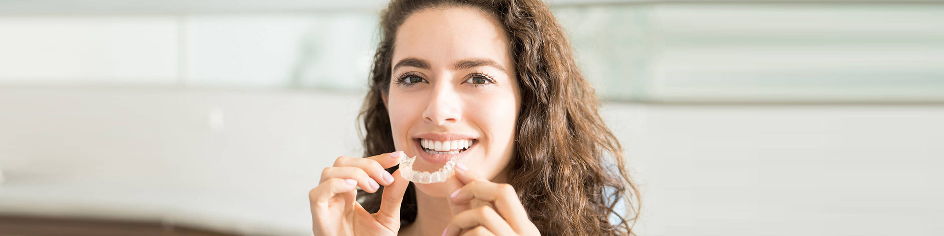 Beautiful girl with Invisalign® treatment