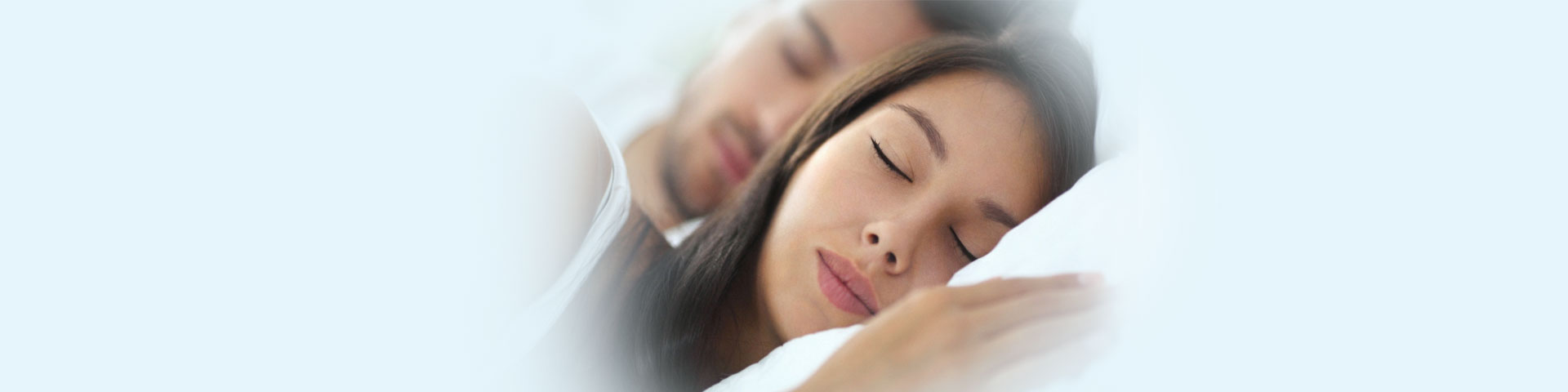 Couple are sleeping comfortably after Sleep Apnea Treatments
