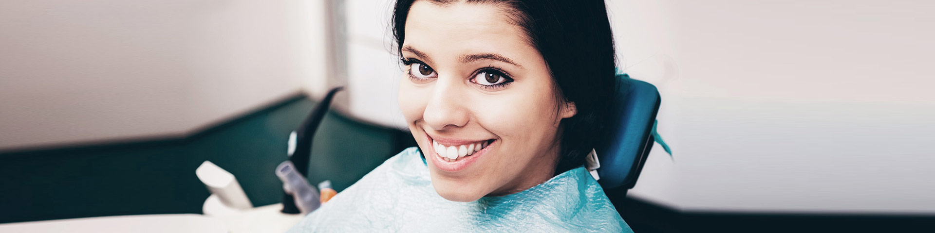 Girl with beautiful smile after Root Canal treatment